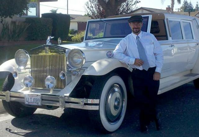 Ryan Taylor leaning against a classic, stretch limo